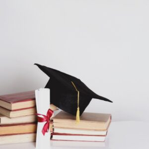 Grad cap, diploma, books